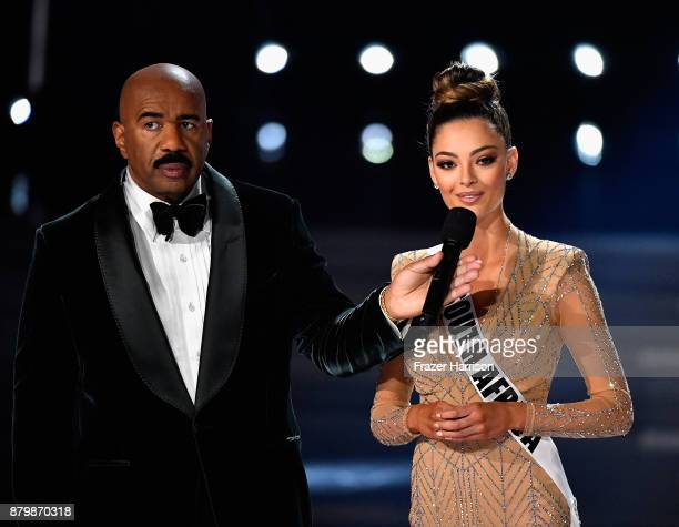 Television personality and host Steve Harvey onstage with Miss South Africa 2017 DemiLeigh NelPeters as she answers a question during the interview...