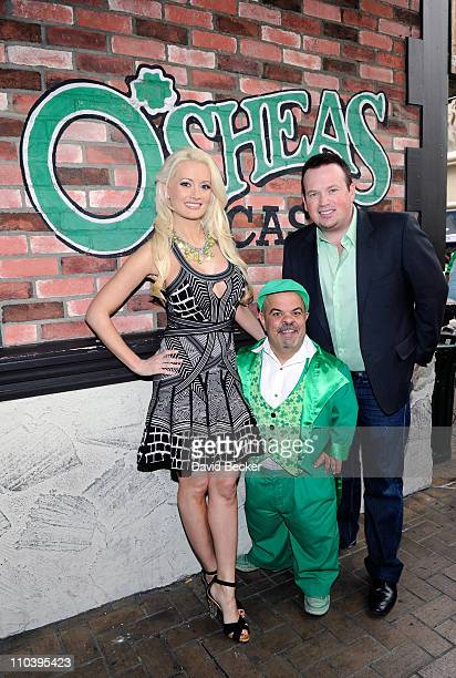 Television personality and model Holly Madison O'Sheas' Lucky Leprechaun Brian Thomas and Illusionist Nathan Burton pose for a postgame picture after...