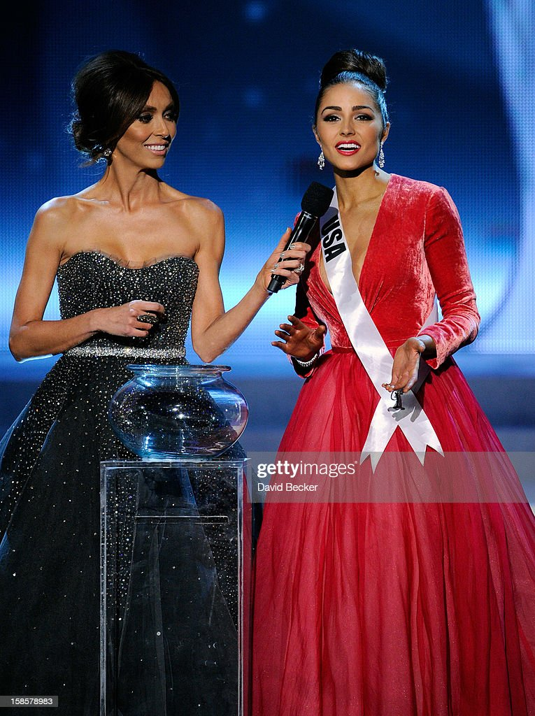 Television personality and pageant co-host <a gi-track='captionPersonalityLinkClicked' href=/galleries/search?phrase=Giuliana+Rancic&family=editorial&specificpeople=556124 ng-click='$event.stopPropagation()'>Giuliana Rancic</a> (L) looks on as Miss USA 2012, Olivia Culpo, answers a question during the interview portion of the 2012 Miss Universe Pageant at PH Live at Planet Hollywood Resort & Casino on December 19, 2012 in Las Vegas, Nevada. Culpo went on to be crowned the new Miss Universe.