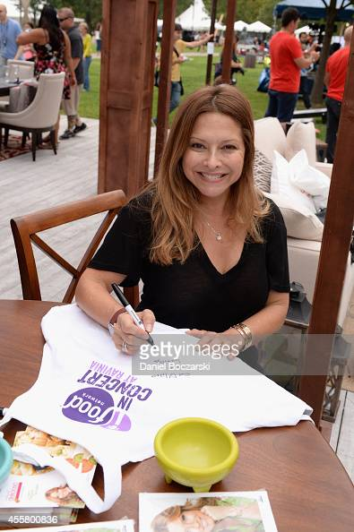television personality and restaurateur Ingrid Hoffman signs books at Food Network in Concert on September 20 2014 in Chicago United States