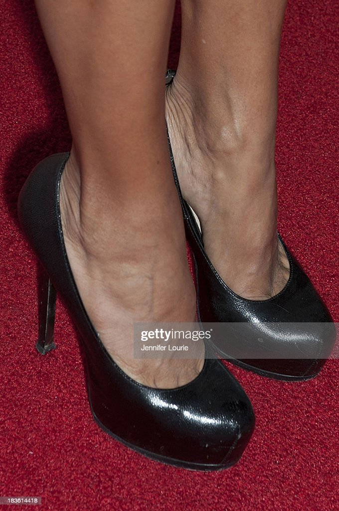 Television personality Azucena Cierco (shoe detail) attends Deportes Telemundo's celebration of their hit show 'Titulares Y Mas' at Ebanos Crossing on October 7, 2013 in Los Angeles, California.