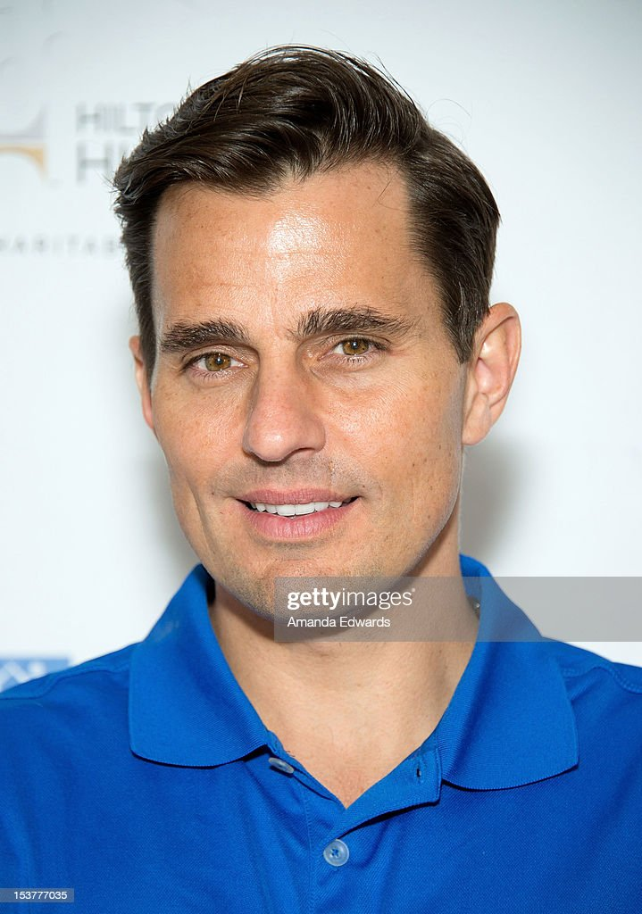 Television personality <a gi-track='captionPersonalityLinkClicked' href=/galleries/search?phrase=Bill+Rancic&family=editorial&specificpeople=204496 ng-click='$event.stopPropagation()'>Bill Rancic</a> arrives at the 6th Annual Hilton HHonors Charitable Golf Series at The Riviera Country Club on October 8, 2012 in Pacific Palisades, California.