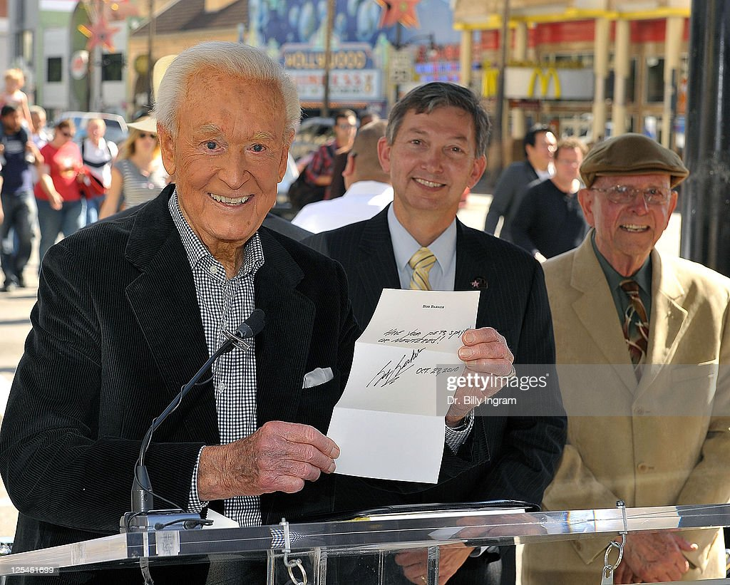 Television personality Bob Barker and Leron Gubler looks on as Bob Barker holds a handwritten letter to be placed in a time capsule until the year...
