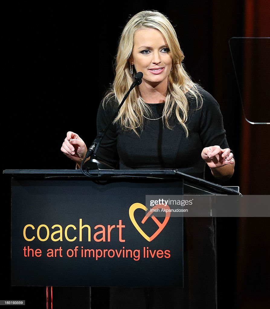 Television personality Brooke Anderson speaks onstage during CoachArt's 9th Annual 'Gala Of Champions' at The Beverly Hilton Hotel on October 17, 2013 in Beverly Hills, California.