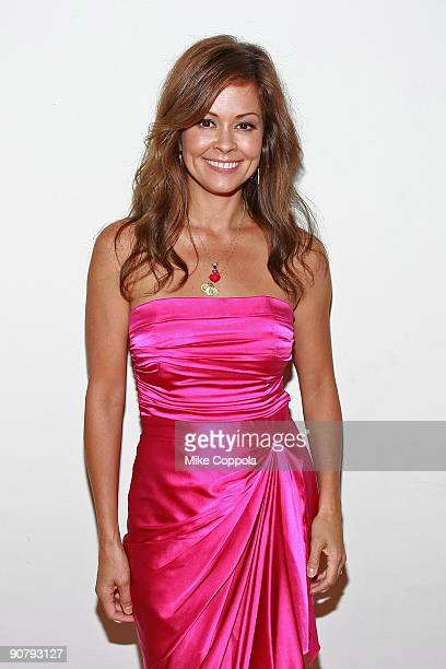 Television personality Brooke Burke attends the Pink Dress Collection event during Style360 Fashion Week at the Metropolitan Pavilion on September 15...