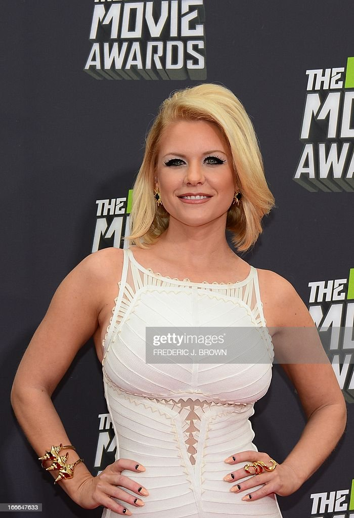 Television personality Carrie Keagan poses on arrival for the 2013 MTV Movie Awards in Los Angeles, California, on April 14, 2013. AFP PHOTO/Frederic J. BROWN