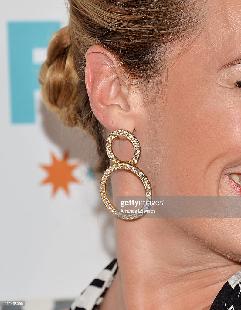 Television personality <a gi-track='captionPersonalityLinkClicked' href=/galleries/search?phrase=Cat+Deeley&family=editorial&specificpeople=202554 ng-click='$event.stopPropagation()'>Cat Deeley</a> (earring detail) arrives at the 2014 Television Critics Association Summer Press Tour - FOX All-Star Party at Soho House on July 20, 2014 in West Hollywood, California.