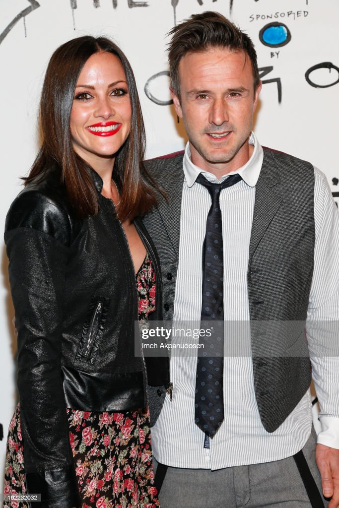 Television personality Christina McLarty (L) and actor David Arquette attend The Art Of Elysium's 6th Annual Pieces Of Heaven Powered By Ciroc Ultra Premium Vodka at Ace Museum on February 20, 2013 in Los Angeles, California.