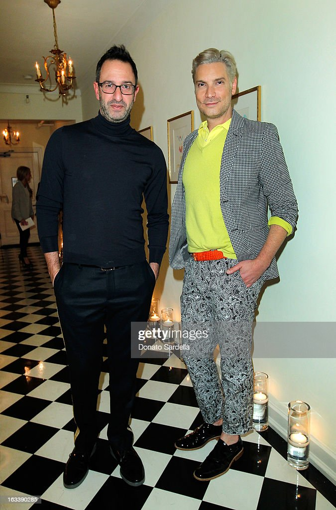 Television personality Christos Garkinos and Cameron Silver attend Joe Fresh private dinner hosted by Joe Mimran and Kate Mara at The Chateau Marmont on March 8, 2013 in Los Angeles, California.