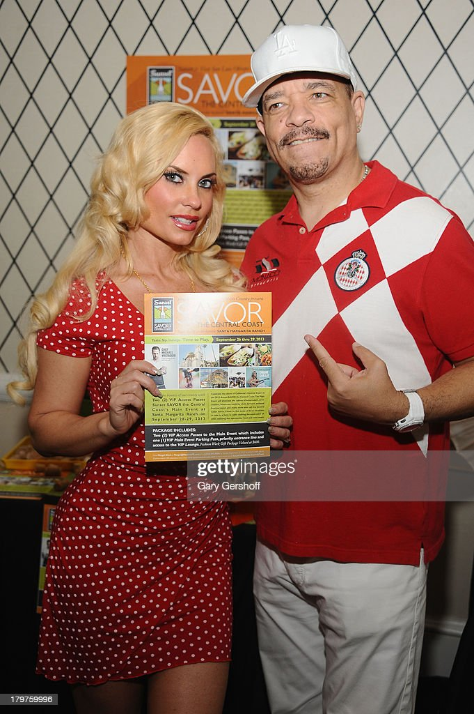 Television personality Coco Austin (L) and actor Ice-T pose at GBK & Sparkling Resort Fashionable Lounge during Mercedes-Benz Fashion Week on September 6, 2013 in New York City.