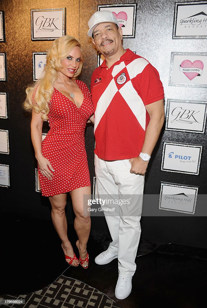 Television personality Coco Austin (L) and actor Ice-T pose at the GBK & Sparkling Resort Fashionable Lounge during Mercedes-Benz Fashion Week on September 6, 2013 in New York City.
