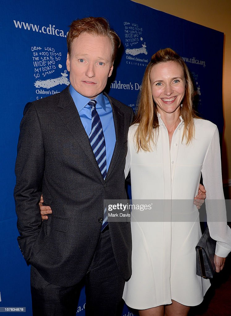 Television personality Conan O'Brien (L) and Liza O'Brien arrive at the Children's Defense Fund of California 22nd Annual Beat The Odds Awards at Beverly Hills Hotel on December 6, 2012 in Beverly Hills, California.
