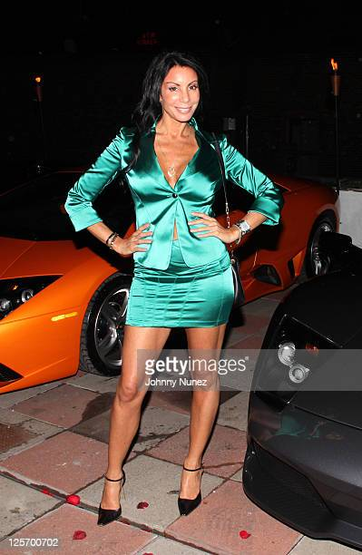 Television personality Danielle Staub attends the NUVO Lemon Sorbet launch and 2012 Lamborghini Aventador LP 7004 unveiling at Manhattan Motorcars on...
