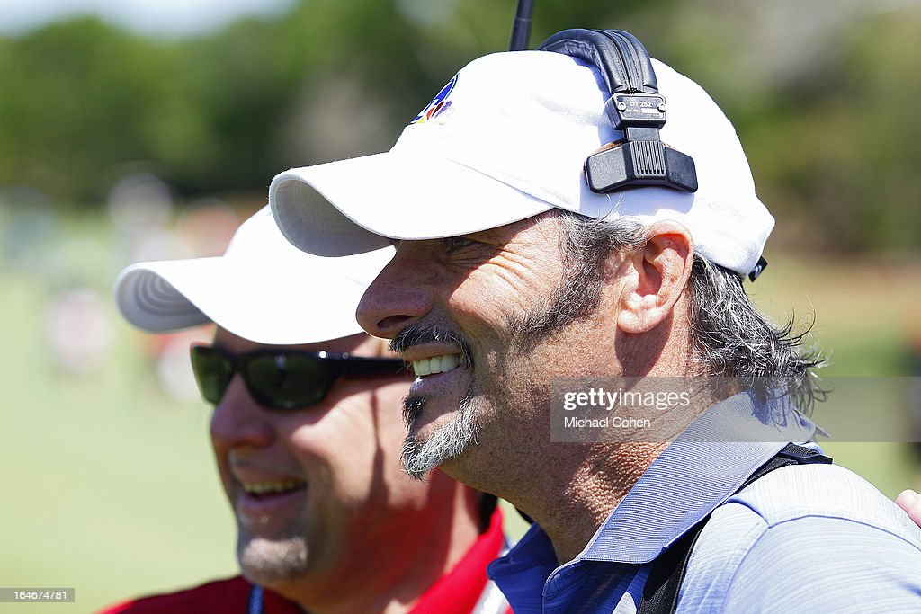 Television personality David Feherty poses with a patron during Day One of the Tavistock Cup held at Isleworth Golf and Country Club on March 25 2013...