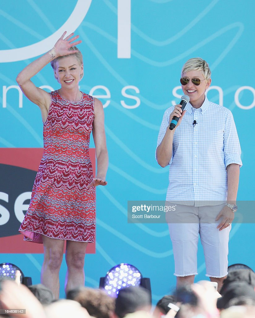 Television personality Ellen DeGeneres and her wife Portia de Rossi appear on stage during the filming of her television show at Birrarung Marr on March 26, 2013 in Melbourne, Australia. DeGeneres is in Australia to film segments for her TV show, 'Ellen'.
