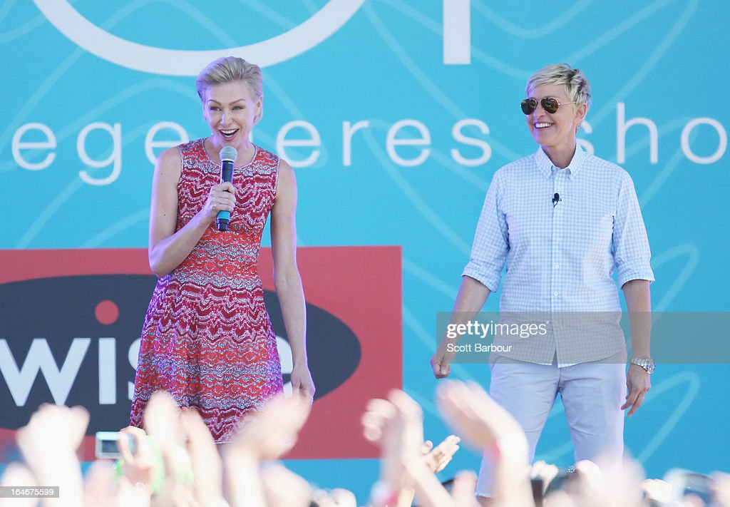 Television personality <a gi-track='captionPersonalityLinkClicked' href=/galleries/search?phrase=Ellen+DeGeneres&family=editorial&specificpeople=171367 ng-click='$event.stopPropagation()'>Ellen DeGeneres</a> (R) and her wife <a gi-track='captionPersonalityLinkClicked' href=/galleries/search?phrase=Portia+de+Rossi&family=editorial&specificpeople=204197 ng-click='$event.stopPropagation()'>Portia de Rossi</a> appear on stage during the filming of her television show at Birrarung Marr on March 26, 2013 in Melbourne, Australia. DeGeneres is in Australia to film segments for her TV show, 'Ellen'.
