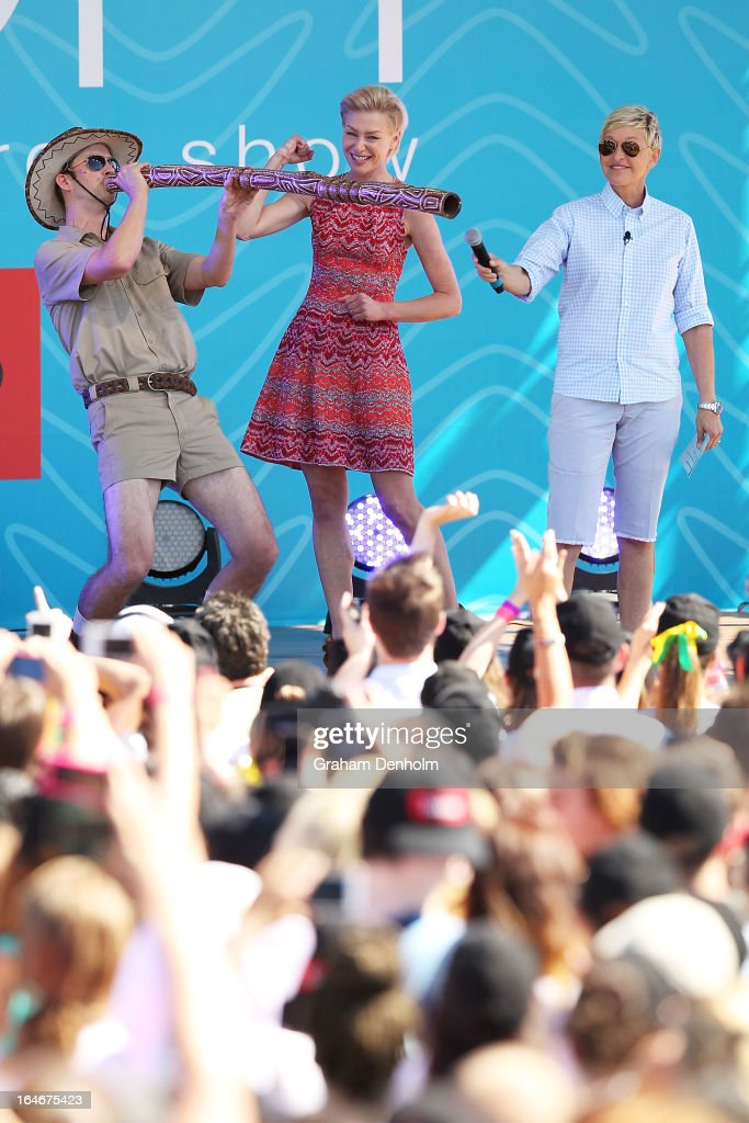Television personality Ellen DeGeneres (R) and Portia de Rossi (C) appear on stage during the filming of her television show at Birrarung Marr on March 26, 2013 in Melbourne, Australia. DeGeneres is in Australia to film segments for her TV show, 'Ellen'.