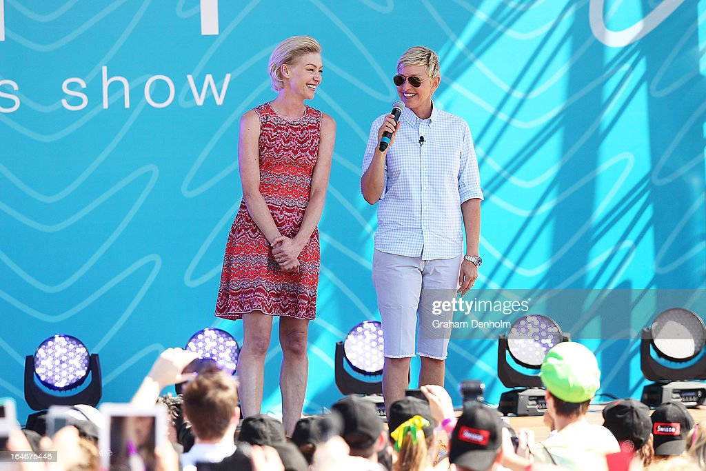 Television personality Ellen DeGeneres (R) and Portia de Rossi appear on stage during the filming of her television show at Birrarung Marr on March 26, 2013 in Melbourne, Australia. DeGeneres is in Australia to film segments for her TV show, 'Ellen'.