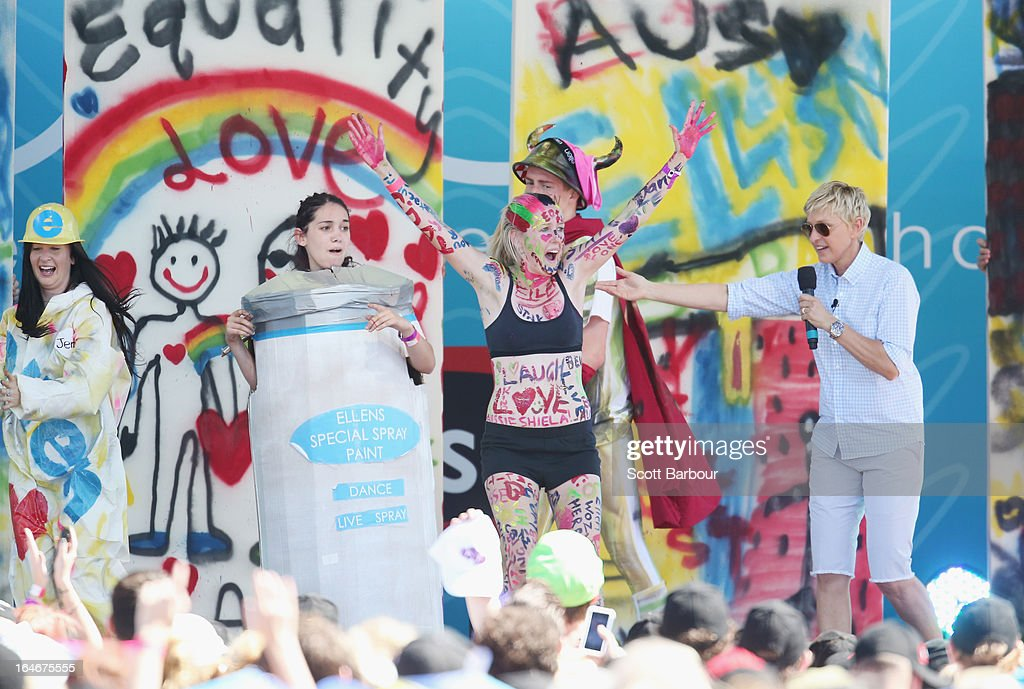 Television personality Ellen DeGeneres (R) appears on stage during the filming of her television show at Birrarung Marr on March 26, 2013 in Melbourne, Australia. DeGeneres is in Australia to film segments for her TV show, 'Ellen'.