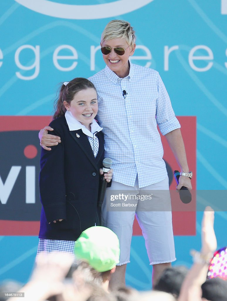 Television personality Ellen DeGeneres appears on stage with schoolgirl Georgia who sung for her during the filming of her television show at Birrarung Marr on March 26, 2013 in Melbourne, Australia. DeGeneres is in Australia to film segments for her TV show, 'Ellen'.