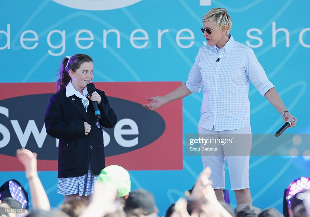 Television personality <a gi-track='captionPersonalityLinkClicked' href=/galleries/search?phrase=Ellen+DeGeneres&family=editorial&specificpeople=171367 ng-click='$event.stopPropagation()'>Ellen DeGeneres</a> appears on stage with schoolgirl Georgia who sung for her during the filming of her television show at Birrarung Marr on March 26, 2013 in Melbourne, Australia. DeGeneres is in Australia to film segments for her TV show, 'Ellen'.