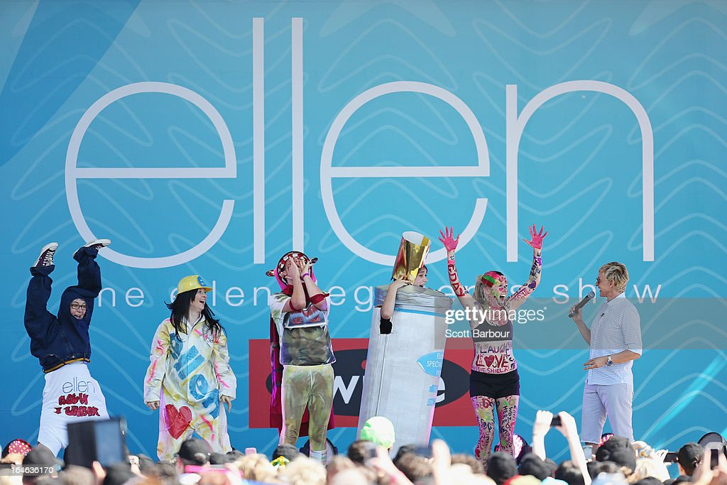 Television personality Ellen DeGeneres appears on stage with members of the audience who had dressed up for the occasion during the filming of her television show at Birrarung Marr on March 26, 2013 in Melbourne, Australia. DeGeneres is in Australia to film segments for her TV show, 'Ellen'.