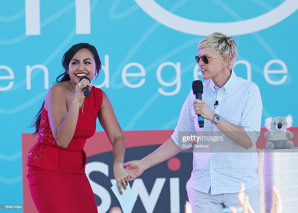 Television personality Ellen DeGeneres (R) appears on stage with Australian singer Jessica Mauboy (C) and a guest from the audience during the filming of her television show at Birrarung Marr on March 26, 2013 in Melbourne, Australia. DeGeneres is in Australia to film segments for her TV show, 'Ellen'.