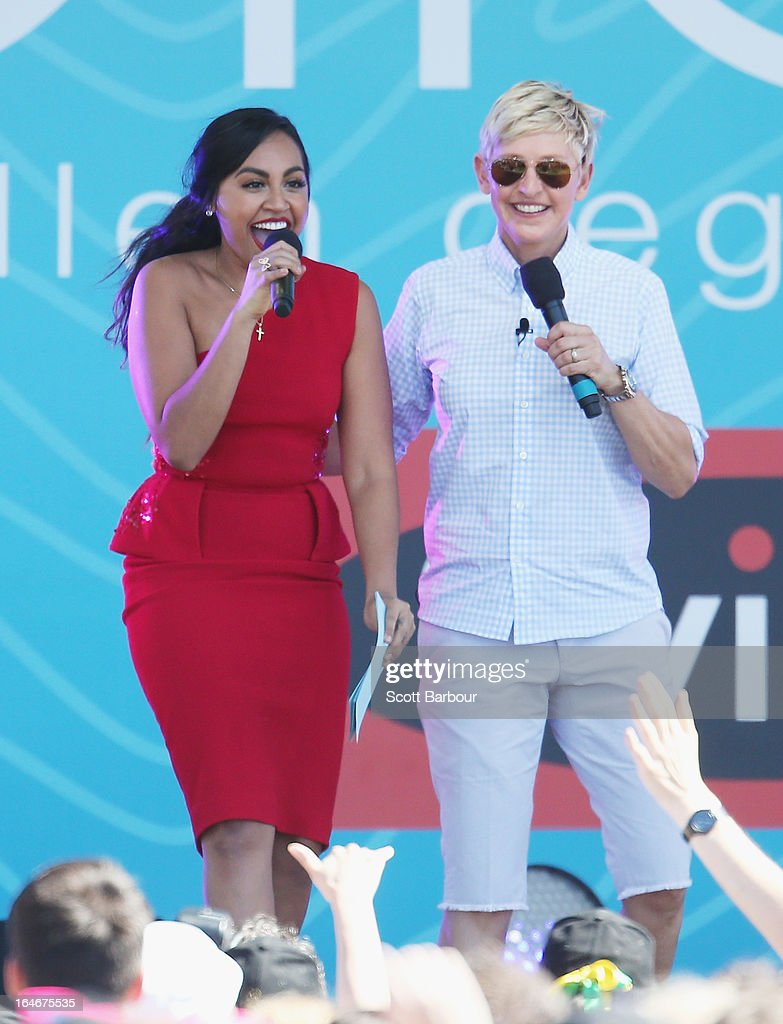 Television personality Ellen DeGeneres (R) appears on stage with Australian singer Jessica Mauboy during the filming of her television show at Birrarung Marr on March 26, 2013 in Melbourne, Australia. DeGeneres is in Australia to film segments for her TV show, 'Ellen'.