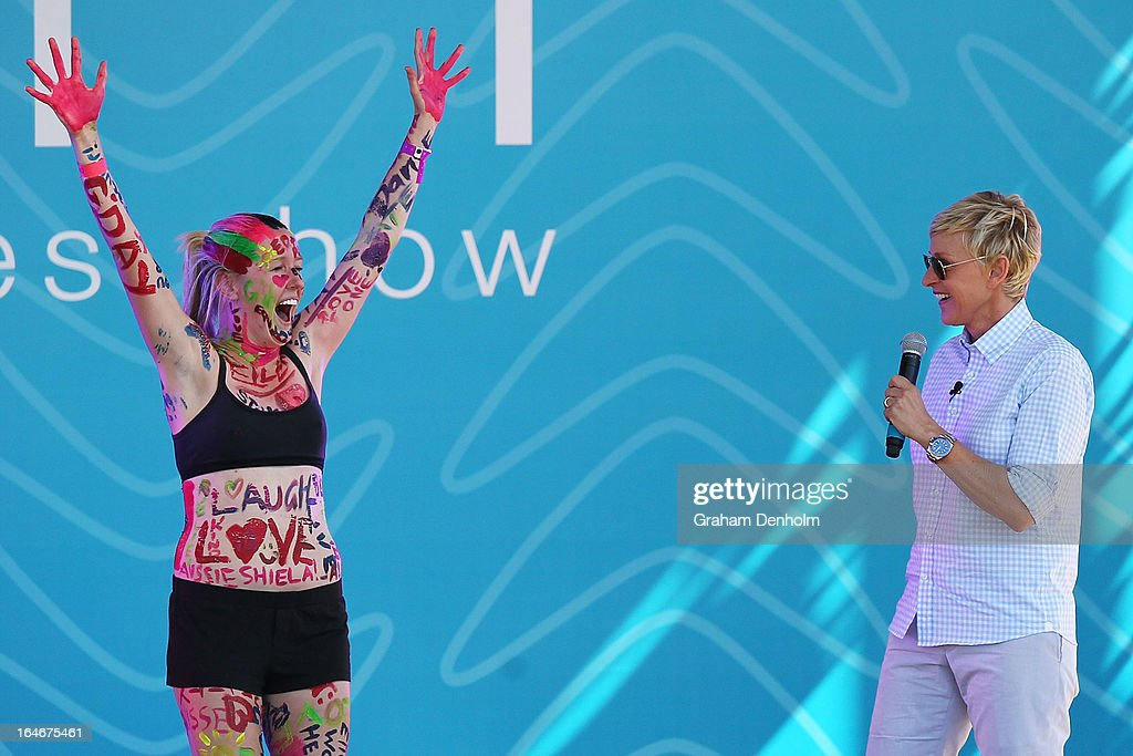 Television personality Ellen DeGeneres (R) appears on stage with the winning contestant during the filming of her television show at Birrarung Marr on March 26, 2013 in Melbourne, Australia. DeGeneres is in Australia to film segments for her TV show, 'Ellen'.