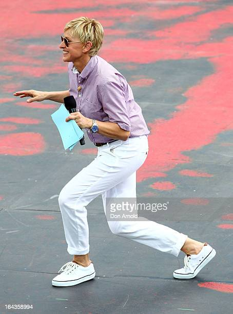 Television personality Ellen DeGeneres dances on the set of her television show being shot on a stage above Sydney Harbour on March 23 2013 in Sydney...