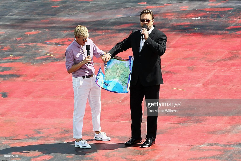 Television personality <a gi-track='captionPersonalityLinkClicked' href=/galleries/search?phrase=Ellen+DeGeneres&family=editorial&specificpeople=171367 ng-click='$event.stopPropagation()'>Ellen DeGeneres</a> greets <a gi-track='captionPersonalityLinkClicked' href=/galleries/search?phrase=Russell+Crowe&family=editorial&specificpeople=202609 ng-click='$event.stopPropagation()'>Russell Crowe</a> on the set of her television show on a floating stage above Sydney Harbour on March 23, 2013 in Sydney, Australia. DeGeneres is in Australia to film segments for her TV show, 'Ellen'