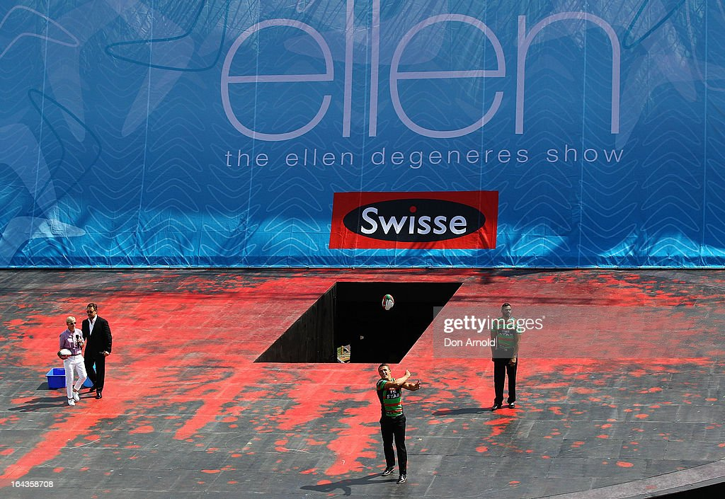 Television personality <a gi-track='captionPersonalityLinkClicked' href=/galleries/search?phrase=Ellen+DeGeneres&family=editorial&specificpeople=171367 ng-click='$event.stopPropagation()'>Ellen DeGeneres</a>, <a gi-track='captionPersonalityLinkClicked' href=/galleries/search?phrase=Russell+Crowe&family=editorial&specificpeople=202609 ng-click='$event.stopPropagation()'>Russell Crowe</a>, <a gi-track='captionPersonalityLinkClicked' href=/galleries/search?phrase=Sam+Burgess&family=editorial&specificpeople=2650353 ng-click='$event.stopPropagation()'>Sam Burgess</a> and <a gi-track='captionPersonalityLinkClicked' href=/galleries/search?phrase=Greg+Inglis&family=editorial&specificpeople=597192 ng-click='$event.stopPropagation()'>Greg Inglis</a> throw footballs out to the crowd on the set of her television show being shot on a stage above Sydney Harbour on March 23, 2013 in Sydney, Australia. DeGeneres is in Australia to film segments for her TV show, 'Ellen'