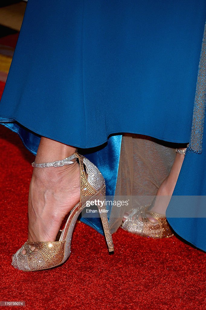 Television personality, fashion expert and pageant commentator Jeannie Mai (shoe detail) arrives at the 2013 Miss USA pageant at Planet Hollywood Resort & Casino on June 16, 2013 in Las Vegas, Nevada.