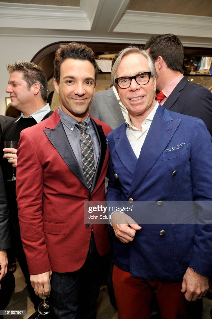 Television Personality George Kotsiopoulos and fashion designer Tommy Hilfiger attend Tommy Hilfiger New West Coast Flagship Opening on Robertson Boulevard on February 13, 2013 in West Hollywood, California.
