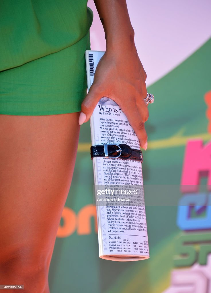 Television personality Gloria Govan (clutch detail) arrives at the Nickelodeon Kids' Choice Sports Awards 2014 on July 17, 2014 in Los Angeles, California.