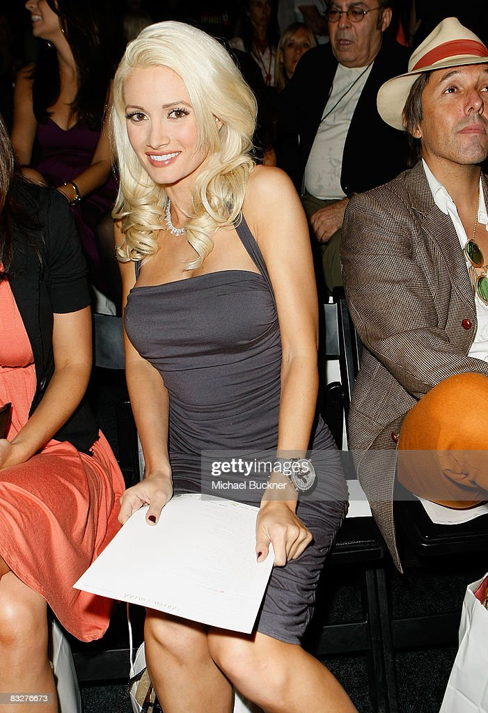 Television Personality Holly Madison poses in the front row at the Lauren Conrad Collection Spring 2009 fashion show during Mercedes-Benz Fashion Week held at Smashbox Studios on October 14, 2008 in Culver City, California.