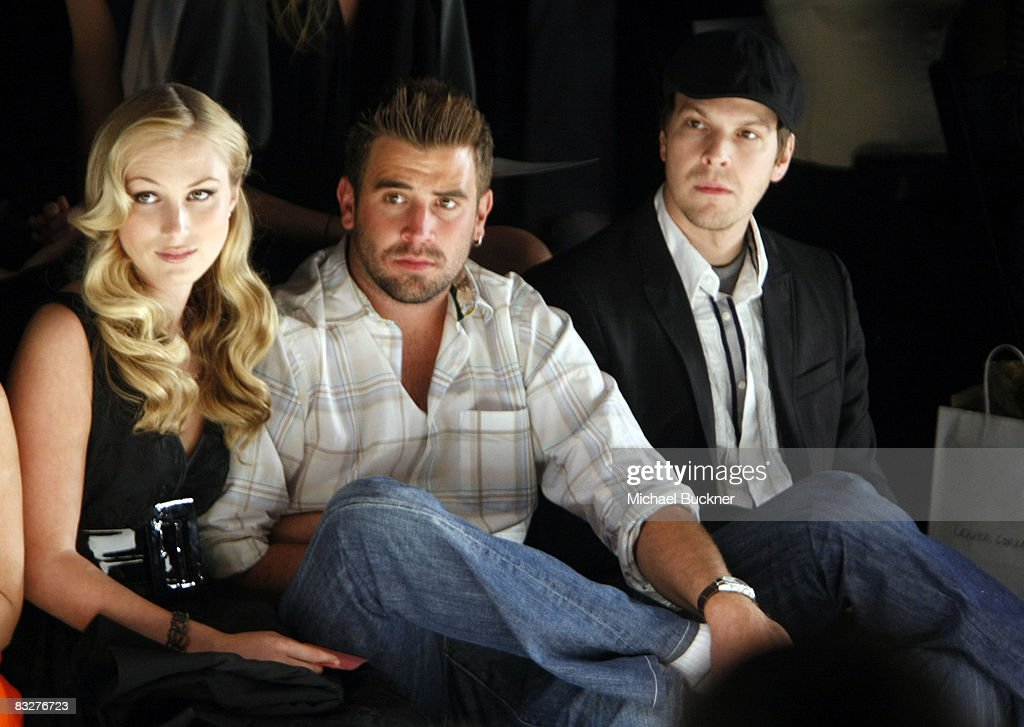 Television Personality Jason Wahler, girlfriend Katja Decker-Sadowski and guest pose in the front row at the Lauren Conrad Collection Spring 2009 fashion show during Mercedes-Benz Fashion Week held at Smashbox Studios on October 14, 2008 in Culver City, California.