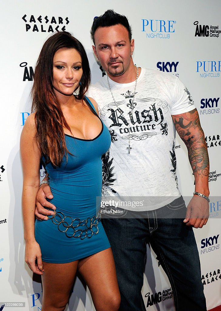 Television personality Jenni 'JWOWW' Farley (L) and her boyfriend Roger Mathews arrive for an appearance at the Pure Nightclub at Caesars Palace early on August 27, 2011 in Las Vegas, Nevada.