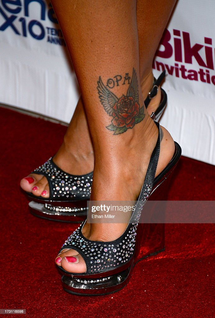Television personality Jenni 'JWOWW' Farley (shoes, tattoo details) arrives at the Hard Rock Hotel & Casino to host the second round of preliminary eliminations for the Rehab Bikini Invitational 2013 on July 7, 2013 in Las Vegas, Nevada.