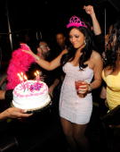 Television personality Jenni 'JWoWW' Farley from the MTV show 'Jersey Shore' is presented with a cake as she celebrates her 25th birthday at Moon...