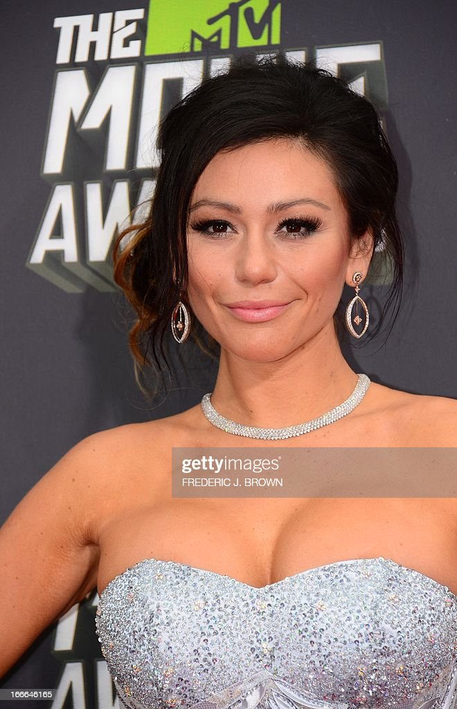 Television personality Jennifer 'JWoww' Farley poses on arrival for the 2013 MTV Movie Awards in Los Angeles, California, on April 14, 2013. AFP PHOTO/Frederic J. BROWN