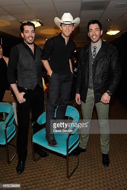 Television personality Jonathan Scott recording artist Justin Moore and television personality Drew Scott attend the Backstage Creations Celebrity...