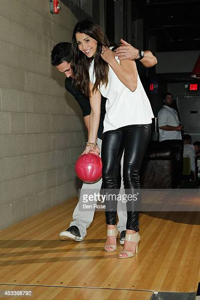 Television personality Josh Murray and television personality Andi Dorfman bowl during a surprise birthday party for Josh Murray thrown by fiance...