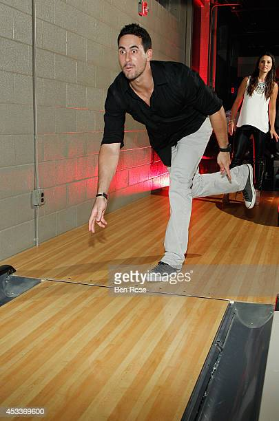 Television personality Josh Murray bowls during a surprise birthday party his fiance Andi Dorfman hosted for him at The Painted Pin on August 8 2014...