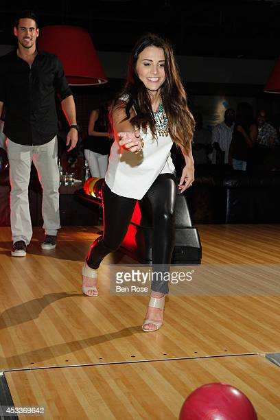 Television personality Josh Murray looks on as his fiance Andi Dorfman bowls during a surprise birthday party for Josh Murray thrown by Andi Dorfman...