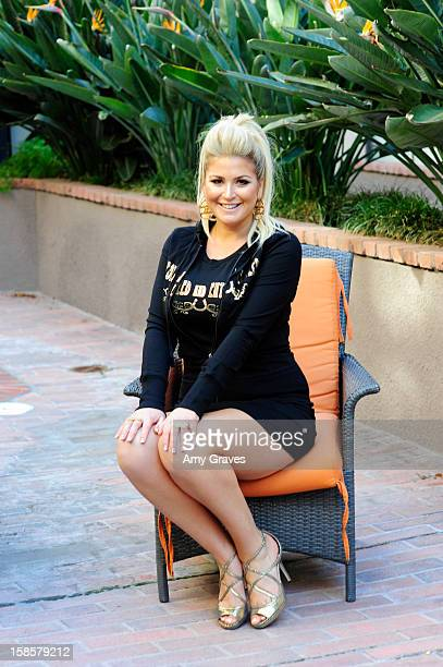 Television personality Josie Goldberg poses for a photo with her Spring 2013 'Spoiled and Entitled' clothing jewelry and chocolate collection on...