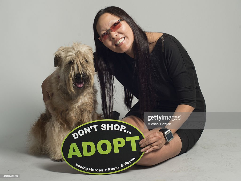 Television personality Joyce Chow poses for Portraits For Pooches on March 30, 2014 in Beverly Hills, California.