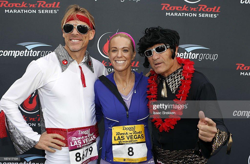 Television personality Kate Gosselin, flanked by Elvis Presley impersonators, arrives at the Zappos.com Rock 'n' Roll Las Vegas Marathon on December 2, 2012 in Las Vegas, Nevada.