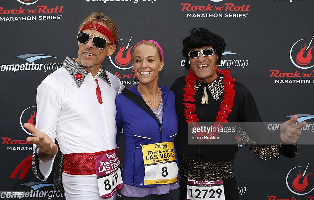 Television personality Kate Gosselin, flanked by Elvis Presley impersonators, arrives at the Zappos.com Rock 'n' Roll Las Vegas Marathon on December 2, 2012 in Las Vegas, Nevada.