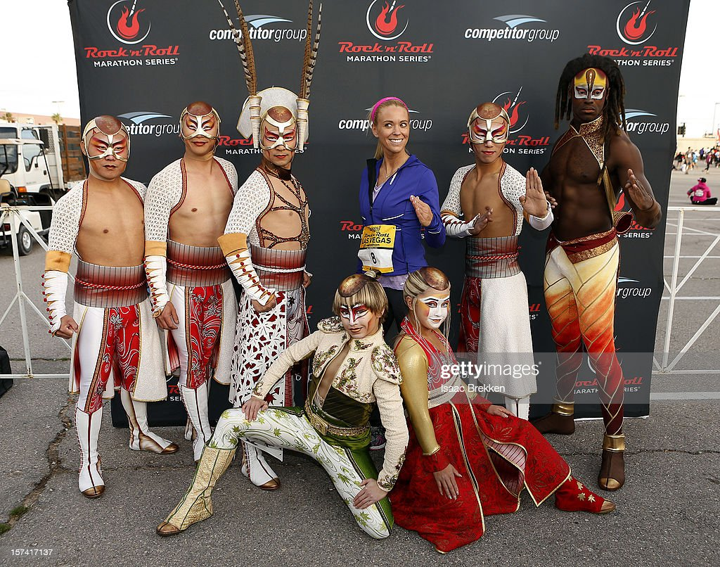 Television personality Kate Gosselin, flanked by performers from 'KA by Cirque du Soleil' arrives at the Zappos.com Rock 'n' Roll Las Vegas Marathon on December 2, 2012 in Las Vegas, Nevada.